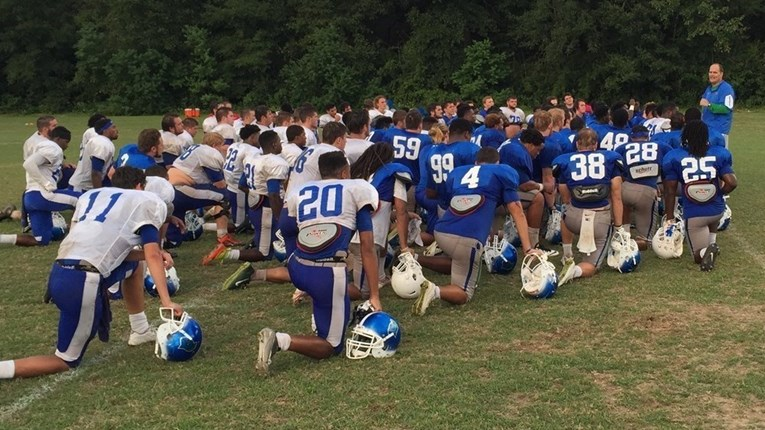 Pete Shinnick addressing the team after practice on Sept. 30